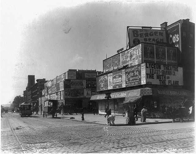 large signs in Times Sq c1905